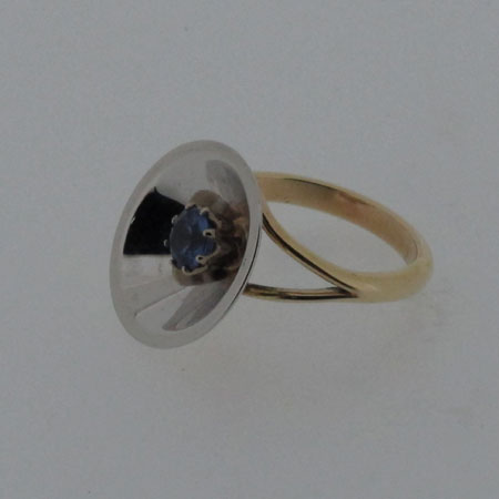 9ct gold tanzanite ring, 9ct yellow gold ring with a round tanzanite mounted in a rhodium plated pan which reflects the setting
