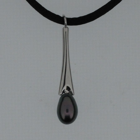 Black pearl and silver necklace, Dropper shaped stained cultured pearl mounted on silver with a black silk suspension