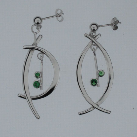 Tsavorite amp Silver Assymetical earrings, Tsavorite and silver asymmetric earrings. tsavorite stones 3.5mm and 3mm. Overall drop 36mm. Rhodium plated and hallmarked in London