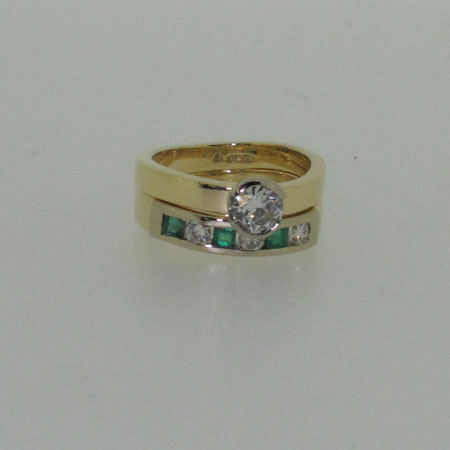 18ct & diamond ring , 18ct yellow gold & 0.70ct certificated diamond ring which is designed to fit a family heirloom emerald & diamond wedding ring
