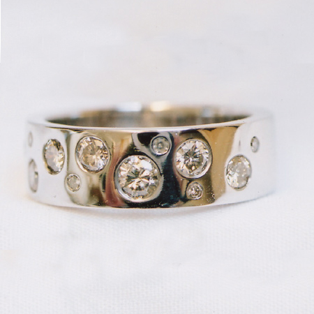 9ct White Gold Ring Rhodium Plated Flush Set With 10 Brilliant Cut Diamonds Ring Reference