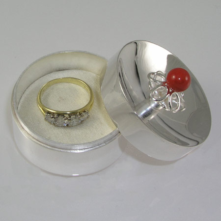 Silver ring box with a red coral knob, Silver box open.