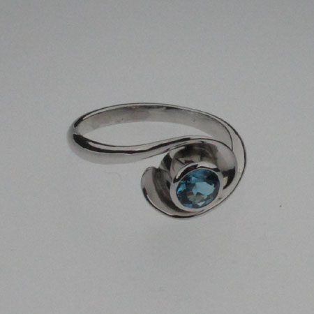 Silver blue topaz ring. 5mm London blue topaz. Rhodium plated and hallmarked in London. Size J