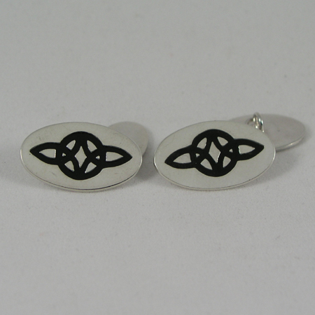 Celtic embossed Silver Cufflinks, Silver cufflinks with the celtic symbol for everlasting love - serch bythol enamelled in the surface. Rhodium plated. Hallmarked in London