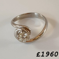 Platinum and diamond ring, Flowing platinum and diamond engagement or dress ring. The brilliant cut diamond is good quality and weighs 0.60cts. Hallmarked.